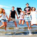 students having fun at the beach after lessons