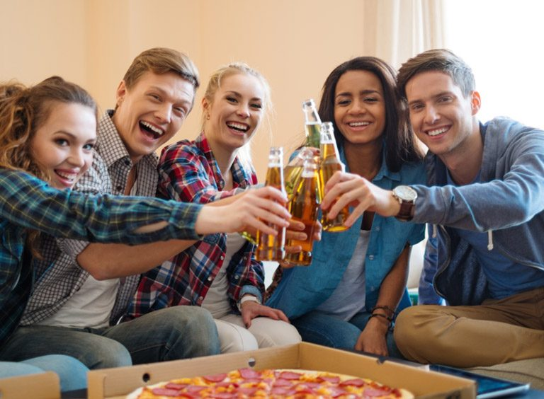 Students having fun together at the apartment